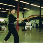 "Performing bo staff kata ""Shima Igiribo Ichiban"" in a Hawaii tournament. Weapons training began at purple belt."